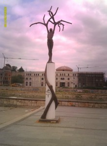 Freedom monument in Skopje, Macedonia. Defaced with graffitti of a Dollar $ sign, it shows to me how the country is now a slave to capitalism, as bad a tyrant as communism.