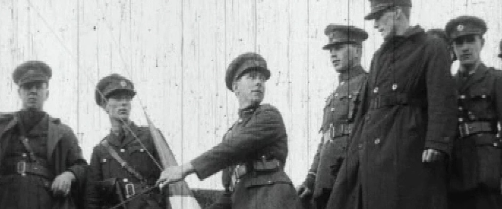 Sean Mac Eoin raising the tricolour at Athlone Barracks some time before the shooting of the sentry McEvaddy
