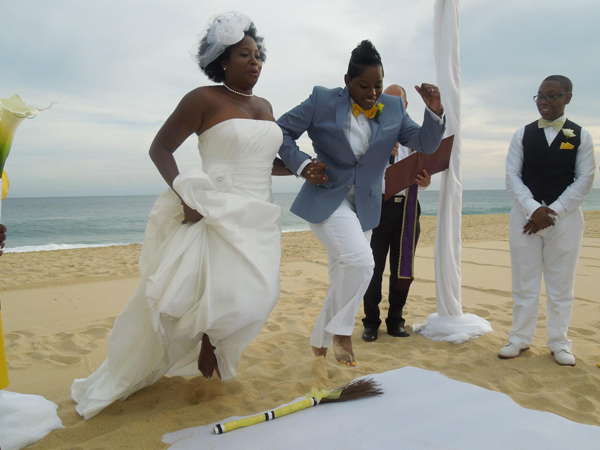US couple jumping the broom