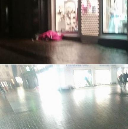 Shots out of focus as I was walking and didnt want to appear to obvuis that I was photographing them. Homeless Couple Asleep under Treasure Chest shop windows on Shop Street in Galway tonight