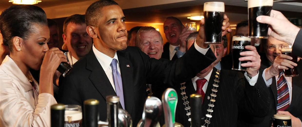 Barack Obama enjoying a pint in Moneygall - some say it takes more than one Irish ancestor and drinking Guinness to call yourself Irish