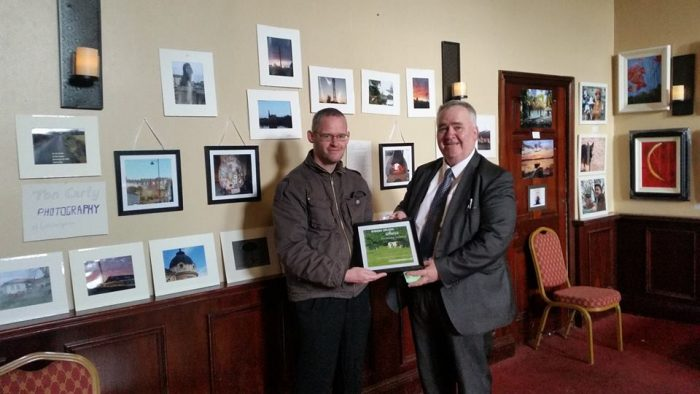 Presenting Willie Penrose with a framed URBAN HORSES meme at Edgeworthstown PIETA House exhibition