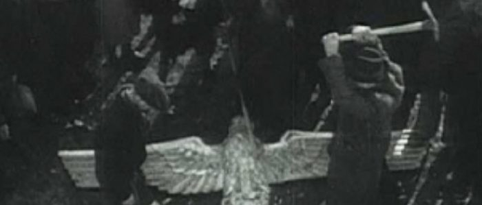 Smashing the Nazi Eagle statue in Mauthausen Concentration Camp in Austria
