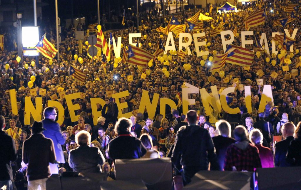 "Pro-independence citizens hold up giant letters reading ""We are ready, Independence"" during the final meeting before the 9N (November 9) consultation, in Barcelona November 7, 2014. Among those on stage are Omnium Cultural President Muriel Casals (2nd R) and Catalan National Assembly (ANC) President Carme Forcadell (C). Catalans are expected to turn out in droves on Sunday to make their strongest show of force to date for breaking away from the rest of Spain in a symbolic independence referendum. But the chances of a formal vote on Catalan autonomy remain slim - partly because regional authorities are themselves divided over how far to go. REUTERS/Gustau Nacarino (SPAIN - Tags: POLITICS ELECTIONS TPX IMAGES OF THE DAY)"